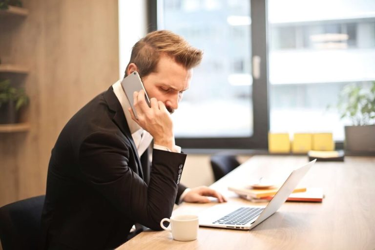 Man in a Conference Room Talking on a Phone