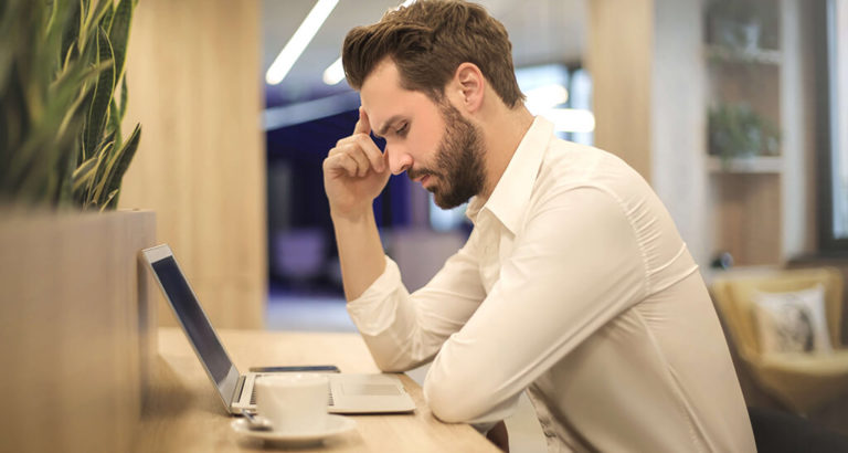 Employee Concentrating on His Computer