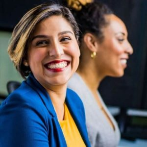 Professional Woman Smiling at Coworker