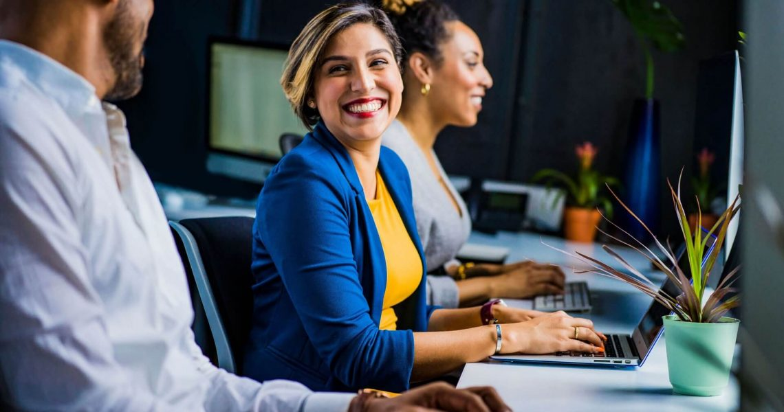 Woman Engaging with Coworkers